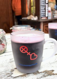 A frosted mug of Glühwein on a white wooden table