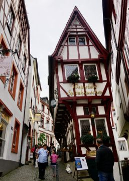 A very narrow half-timbered building