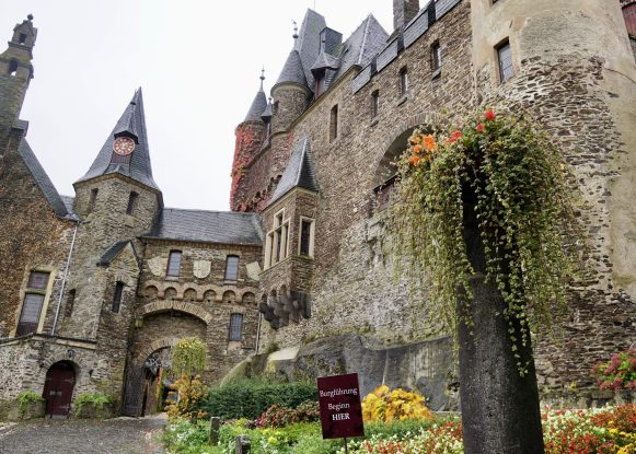 The exterior stone walls of Cochem Castle