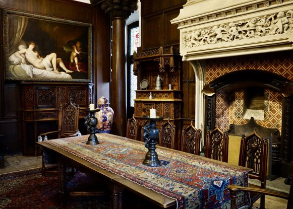 Fireplace, wooden table and painting inside Cochem Castle
