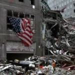 mesothelioma should be covered in 9 11 health care actdebris with american flag at world trade center after 9 11