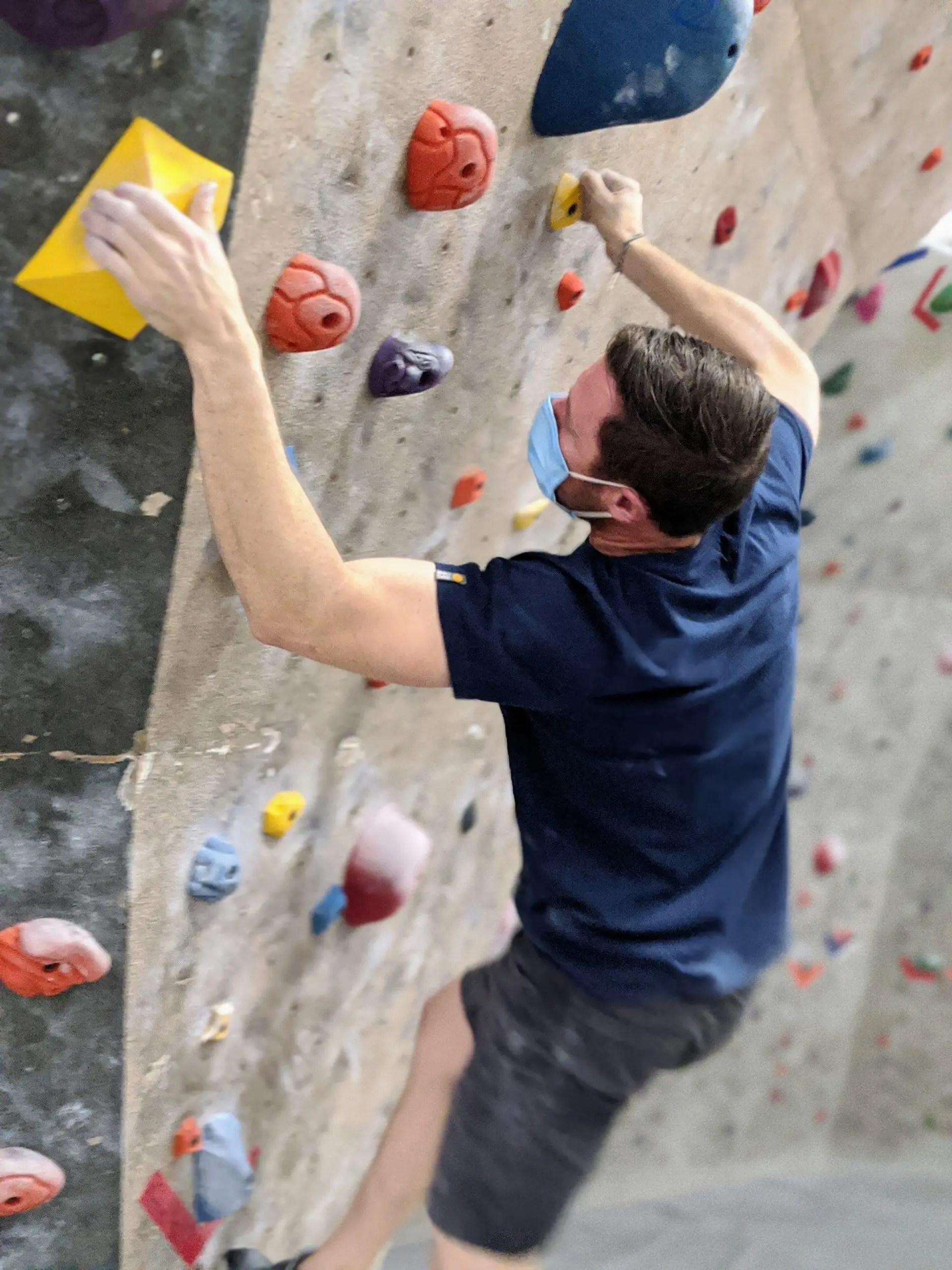 climber climbing yellow hold route