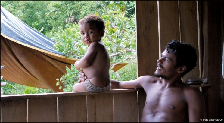 Father and son. Lake Coari. Brazil