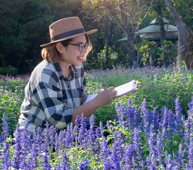 Girl with clipboard in salvia field - Home