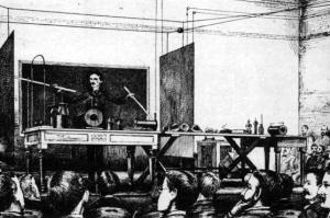 Tesla demonstrates wireless power.