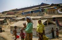 Rohingya women walk through Balukhali camp in Cox's Bazaar,