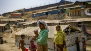 Rohingya women walk through Balukhali camp in Cox's Bazaar,