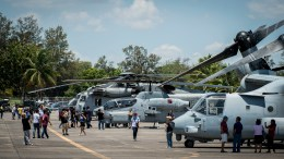 Philippines locals take photos of U.S. military and Philippine Air Force aircraft during a static display at Clark Air Base, Philippines
