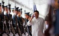 President Rodrigo Duterte walks past the honor guards