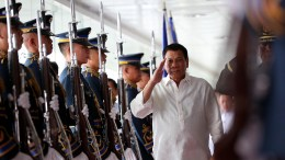 President Rodrigo Duterte walks past the honor guards