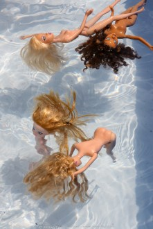 Dolls floating in the pool 02