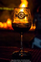 A glass enjoying the fire during the 3rd Annual Fire and Wine Festival at Black Walnut Winery.