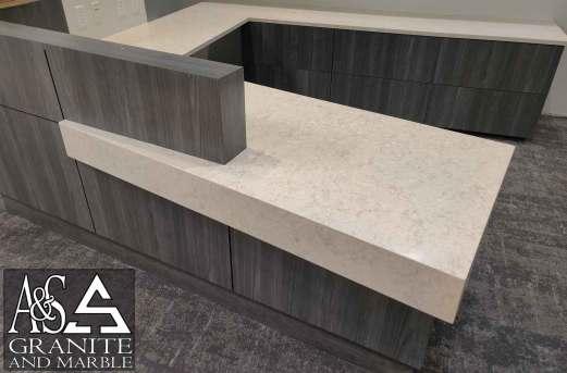 quartz-reception-desk-mitered-waterfall-skirt-side-view