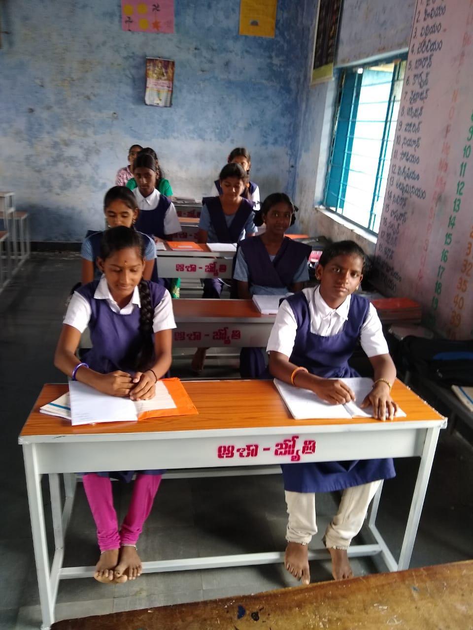 Benches and desks to school children