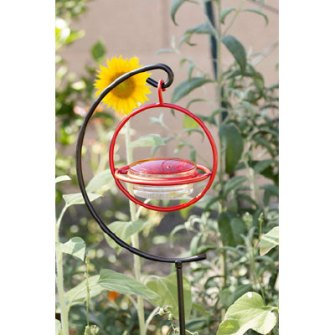 Hummingbird feeder on a stand