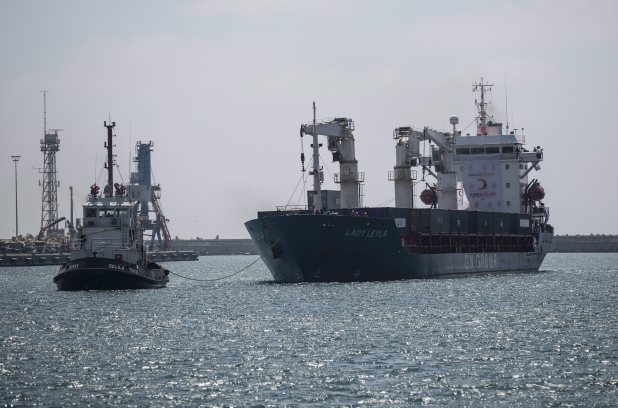 """Panama-flagged """"Lady Leyla"""", a ship carrying Turkish humanitarian aid to Gaza, arrives at the port in the city of Ashdod, Israel, Sunday, July 3, 2016. The first Turkish aid shipment to Gaza since Ankara reconciled with Israel after a six-year spat has arrived in an Israeli port Sunday with 10,000 tons of aid, including food, toys, clothes and shoes destined for Gaza ahead of the upcoming Muslim holiday of Eid al-Fitr. (AP Photo / Tsafrir Abayov)"""