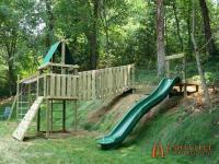 Playground uses the backyard hill for slide and suspension ...