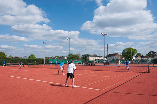 Adult tennis mix in social play