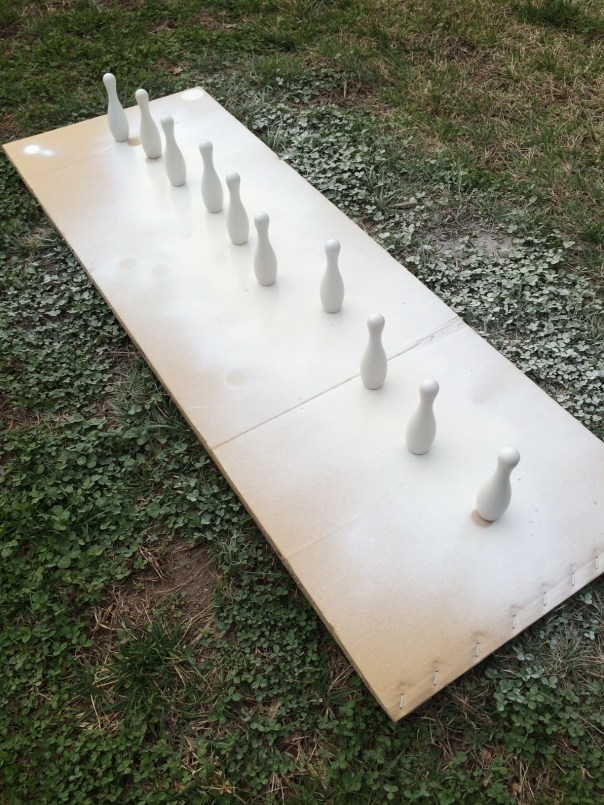 Bowling pins lined up for painting