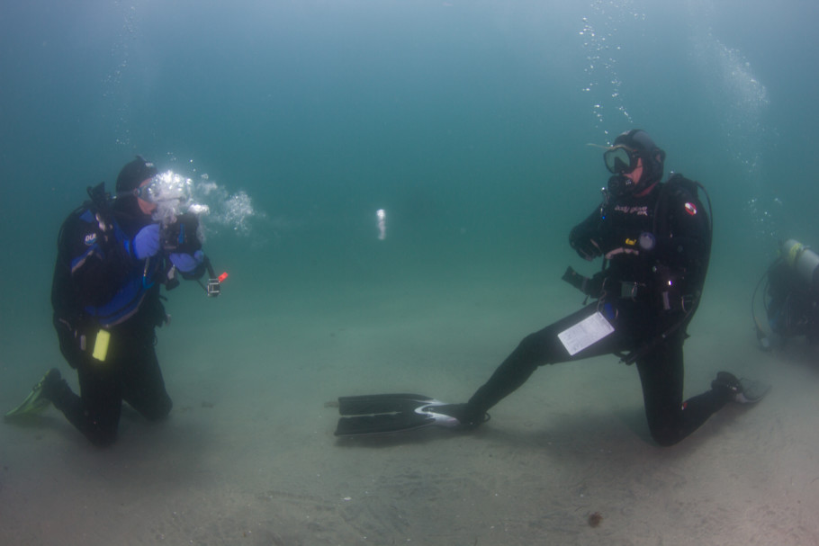 Members of Team Amazing play with the Torid Pulse underwater bubble ring gun