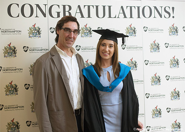With my daughter Chloe in front of the Congratulations sign at the Royal & Derngate during the University of Northampton's Graduation Award Ceremony.
