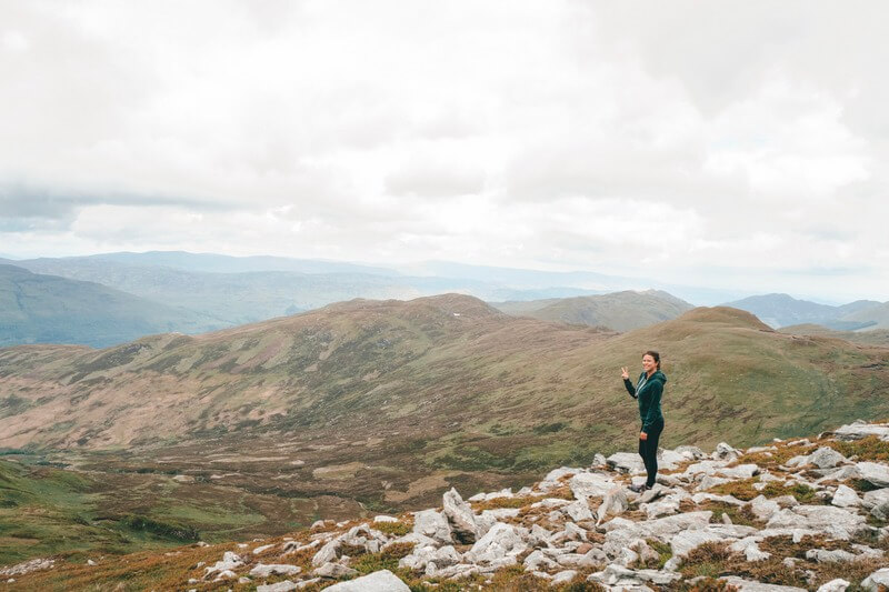Person standing at the top of a Munro in Scotland