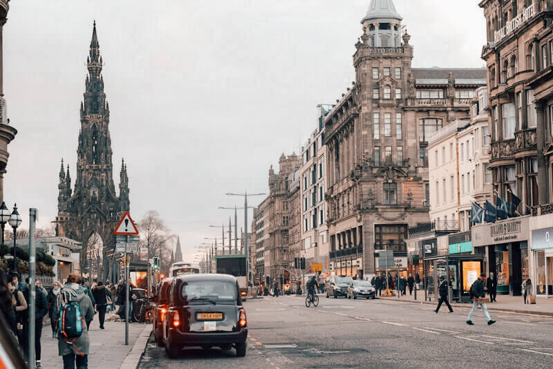 Black taxis parked along Princes Street in Edinburgh, Scotland