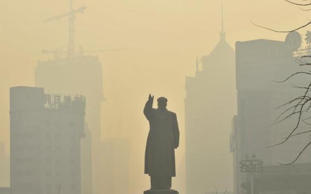 cina statua di mao inquinamento