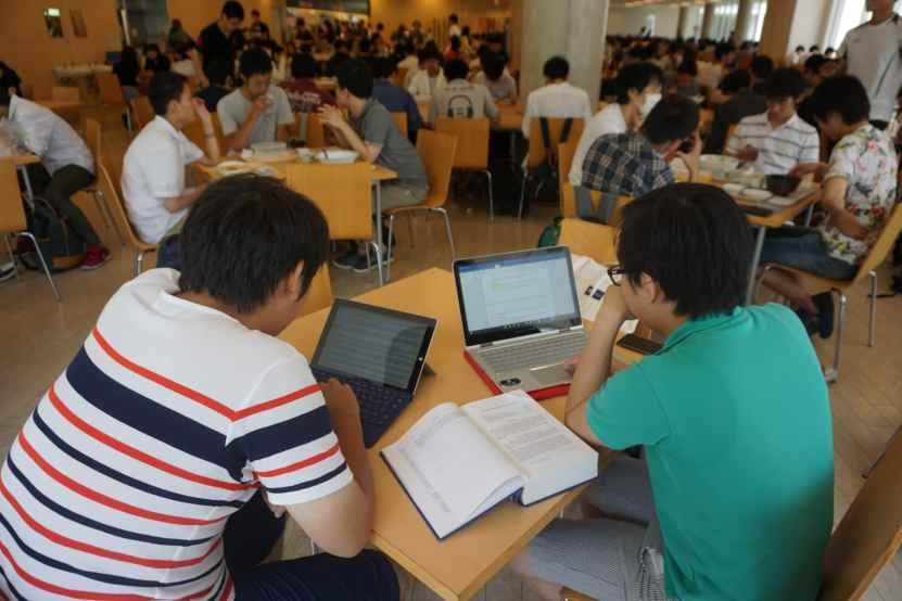 Clarence and Junya working on a report for an intercollegiate competition as a part of the International Law Collegium in the Komaba campus' cafeteria - New Colombo Plan Scholarship to Japan