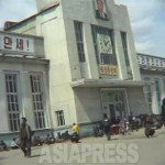 """[2005] Chongjin railway station, North Hamkyung Province. The picture was taken in June 2005. Only Kim Il-sung's portrait can be seen. Alongside the portrait, the slogan reads """"Long live the Great Leader Comrade Kim Jong-il!"""" """"Long live the glorious Korean Workers' Party!"""" (June/2005 North Hamkyung Province) ASIAPRESS"""