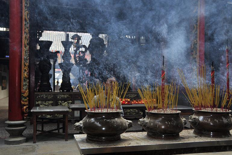 Incense ritual in a temple