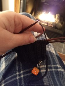 knitting mittens by the fire