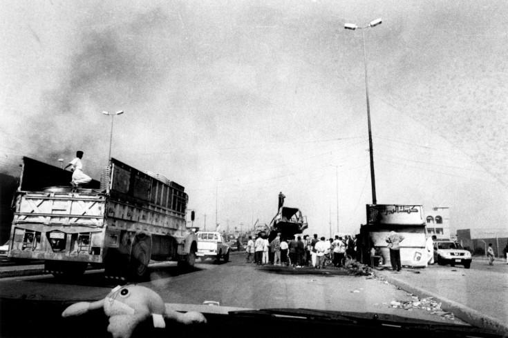 Iraq, Fallujah, people gathered on road (B&W)