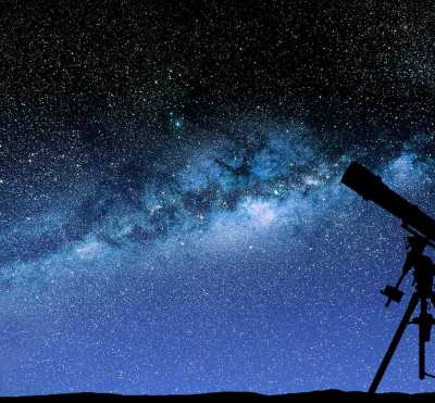 An image of a telescope and a starry sky