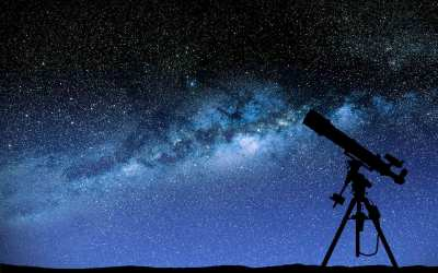 An image of a telescope and a starry night sky
