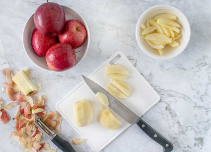 overhead view of slicing apples for cake