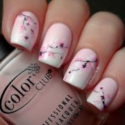 hot pink nail with white flower