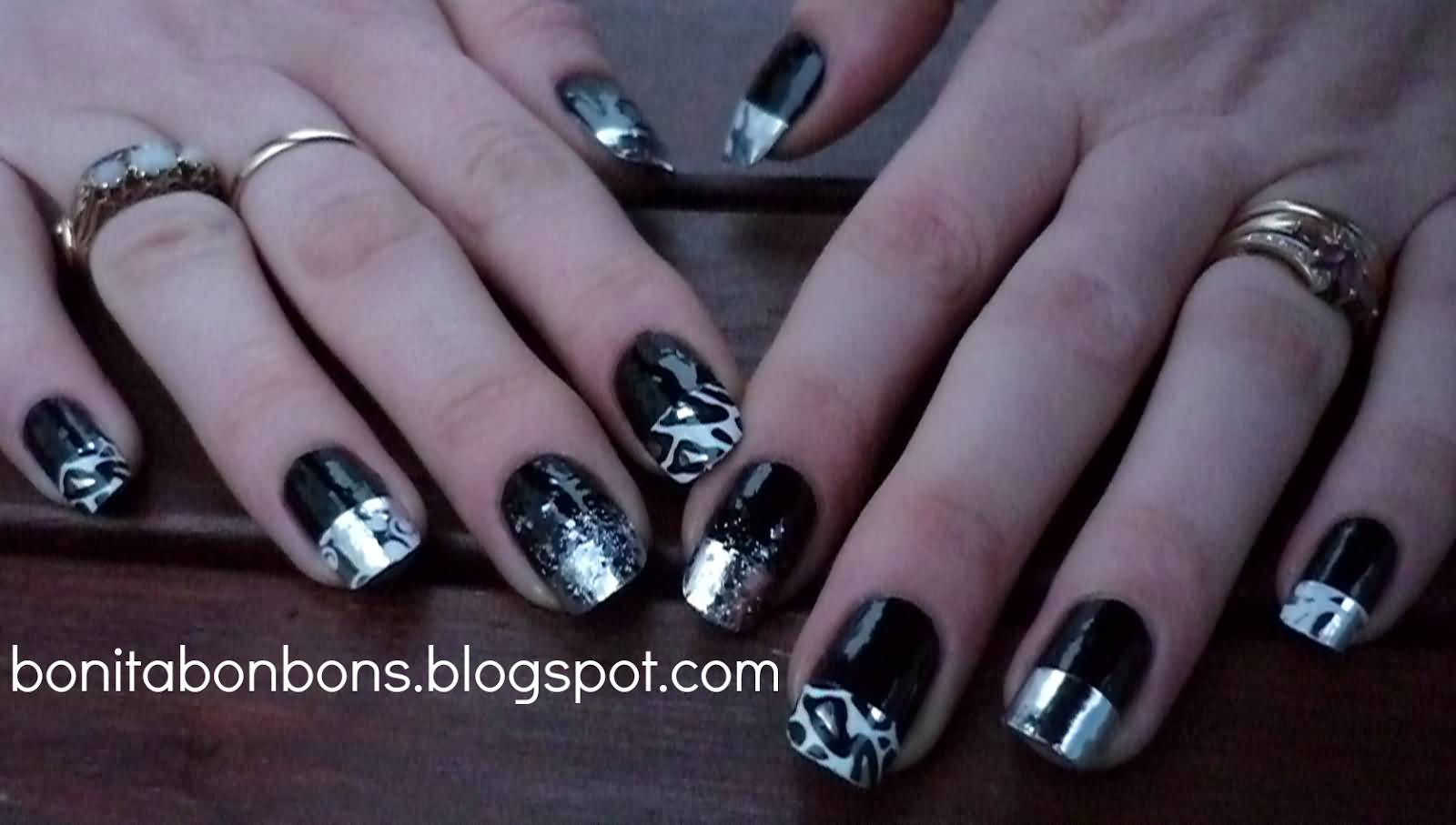 Blue Nails With Black And Silver Feather Nail Art