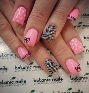 polka dots and bow nail art