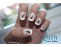 White Tip Nails With Hanging Feathers Design