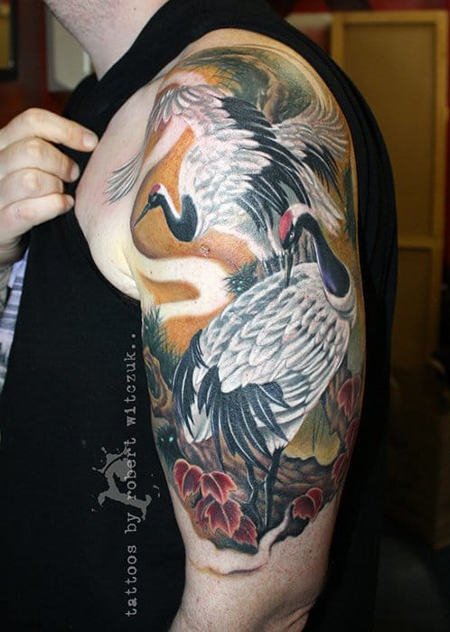 Amazing Crane Tattoo On Left Half Sleeve By Robert Witczuk