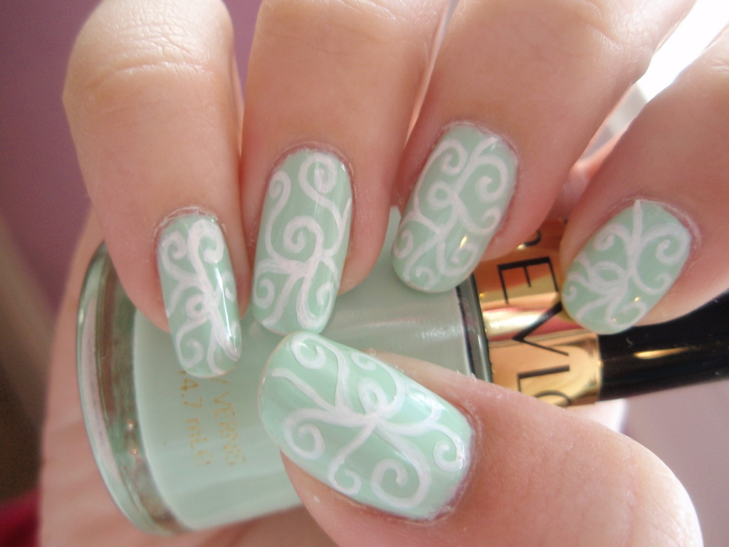 Green Nails With White Spiral Design Winter Nail Art
