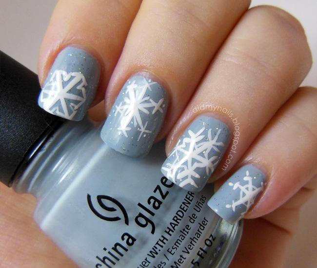 Grey Base Nails With White Snowflakes Winter Nail Art