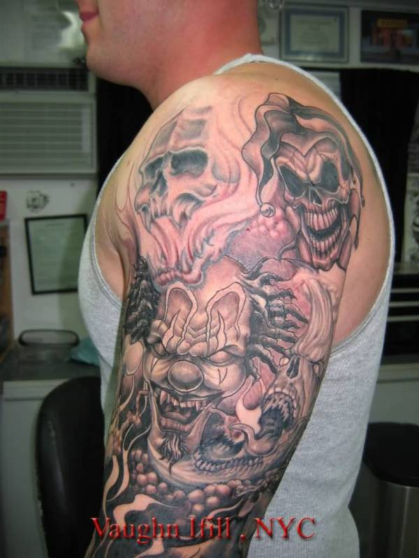 grey inked full arm evil skulls