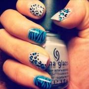 blue and black animal print nail