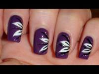 Purple Nails With Black And White Flower Nail Art
