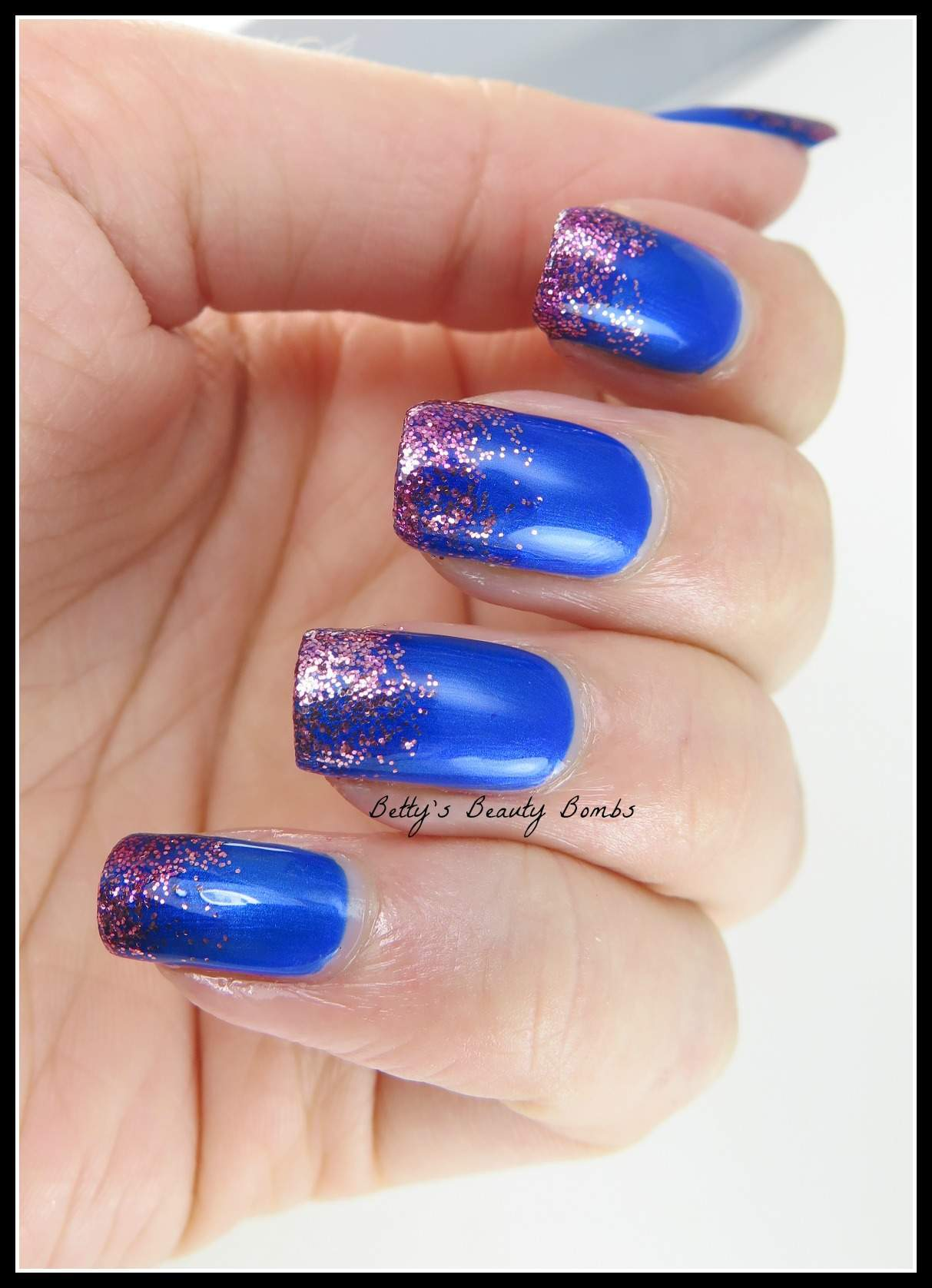 Blue Nails With Purple Glitter Tips Nail Art