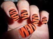 stylish orange and black nail