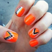 glossy orange with black and white