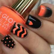 stylish orange and black nail